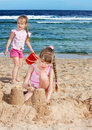 Children playing on  beach. Royalty Free Stock Photos