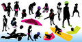Children playing on the beach, silhouettes Royalty Free Stock Photos