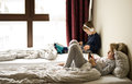 Children playing in bed with their tablets and phones