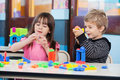 Children playing with blocks in classroom little Stock Photos