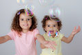 Children playing bubbles Royalty Free Stock Photo