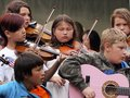 Children playing fiddles and guitars at national aboriginal celebration june edmonton alberta Royalty Free Stock Image