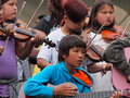 Children playing fiddles and guitars at national aboriginal celebration june edmonton alberta Royalty Free Stock Photo