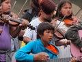 Children playing fiddles and guitars at national aboriginal celebration june edmonton alberta Royalty Free Stock Photo