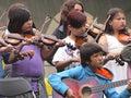 Children playing fiddles and guitars at national aboriginal celebration june edmonton alberta Royalty Free Stock Photography