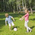 Children playing football Royalty Free Stock Images