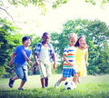 Children playing football fun togetherness concept Royalty Free Stock Photos