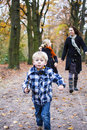 Children playing in forest or walking the with mother concept of family values or healthy life Stock Photo