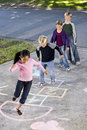 Children playing hopscotch Stock Photos