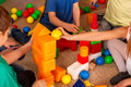 Children playing in kids cubes indoor. Lesson in primary school. Royalty Free Stock Photo
