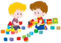 Children playing little boys play with a toy train and bricks Stock Image