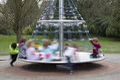 Children playing merry go round