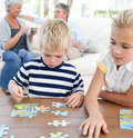 Children playing puzzle in the living room Royalty Free Stock Photo