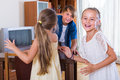 Children playing romp game happy american touch last at home Stock Photo