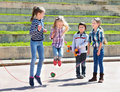 Children playing skipping rope jumping game