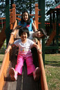 Children playing slide Royalty Free Stock Photos