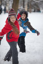 Children playing with snow Royalty Free Stock Photo