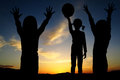 Children playing and sunset evening sky Royalty Free Stock Photo