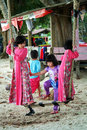 Children playing swing set asian at the beach Stock Image