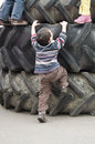 Children playing on tires Stock Photo