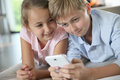 Children playing together on smartphone