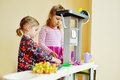 Children playing toy kitchen Royalty Free Stock Photo