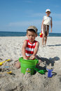 Children playing with toys on the beach Stock Photography