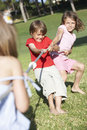 Children playing tug of war Stock Images