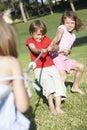 Children playing tug of war Stock Photos