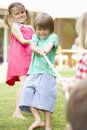 Children playing tug of war Royalty Free Stock Photography