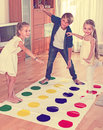 Children playing twister at home