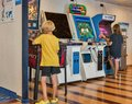 Children plays fighting game on arcade machine. Moby ferry ship