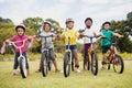 Children posing with bikes Royalty Free Stock Photo