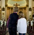 Children praying together inside a church Royalty Free Stock Photo