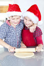 Children preparing christmas cake Royalty Free Stock Photos