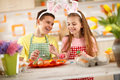 Children preparing colorful Easter eggs Royalty Free Stock Photo