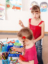 Children  prescooler with pencil in play room. Royalty Free Stock Photography