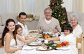 Children pulling a Christmas cracker at home Royalty Free Stock Photo