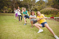 Children pulling a rope in tug of war Royalty Free Stock Photo