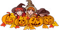 Children and pumpkins on halloween in fancy dress sit behind watch carefully Royalty Free Stock Image