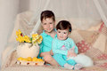 Children and rabbit on a colored blanket in blue suits with white flowers lemons Stock Photo