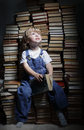 Children reach for a book indoors Royalty Free Stock Photo