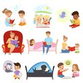 Children reading books and dreaming, parents reading bedtime stories for their kids, imagination and fantasy concept Royalty Free Stock Photo