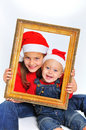 Children in red christmas hats Royalty Free Stock Images