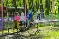 Children ride on the carousel on the childrens playground Royalty Free Stock Photo