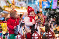 Children riding carousel on Christmas market Royalty Free Stock Photo