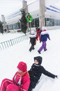 Children riding sleighs in bucharest during heavy snowfall Stock Photography