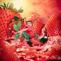 Children riding strawberry fruit landscape two kids are strawberries on a red wet juicy river with a in the background the look Royalty Free Stock Photography