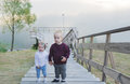 Children are on the river jetty little brother and the sister walk upstairs Stock Images