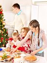 Children rolling dough in kitchen. Royalty Free Stock Images